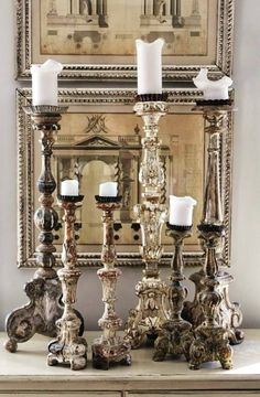 A perfect way to accessorize any room is with multiple candle holders varying in heights.