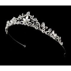 Add the finishing touch to your bridal hairstyle with this delicately designed silver rhinestone tiara.