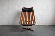"- Hans Brattrud, 1960's, Norway - 43"" H, 29"" W, 42"" D - Rosewood, Vinyl, Steel Hans is recognized as one of Scandinavia's prominent furniture designers from the mid-century modern era. The Scandia Lou"