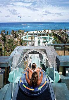 FJK - Atlantis Slide in the Bahamas.  Speeds of up to 35 mph through clear slide ending up with journey through shark infested lagoon.
