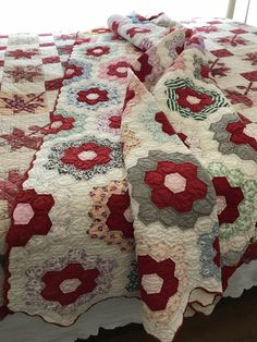 1930s hexagon quilt - gorgeous use of red with pink centres and great fabrics from the scrap basket.