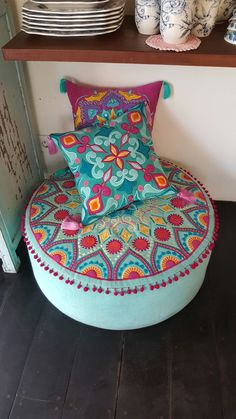 Bali furniture Exotic embroidered pillows and otyoman in Aqua blue and vibrant stitching. Love this set <3