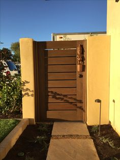 Custom Contemporary Wood Gate with Slatted Body by Garden Passages