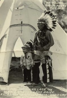 Sioux holy man Nicholas Black Elk is shown with his grandson, George Looks Twice, in this photo that was probably taken in the late 1930s.