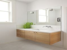 Bathroom. floating light brown wooden vanity with white counter top and sink also long mirror on the white wall. Fascinating Floating Mirror Bathroom Perfecting Your Bathroom