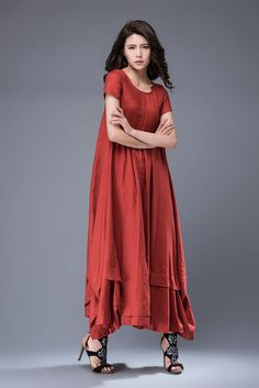 Glide through gardens with grace in this exquisite red linen dress. With a loose-fitting style and relaxed vibe, this beautiful dress will capture the heart from the moment youre adorned in its elegant charm. Featuring a layered hemline and gorgeous pintucks on the bodice, this little wonder is bound to bring a chipper mood to everyone around you. Beautifully romantic and feminine, this dress could be worn to just about any kind of occasion on a hot summers day.  You may also like casual red…