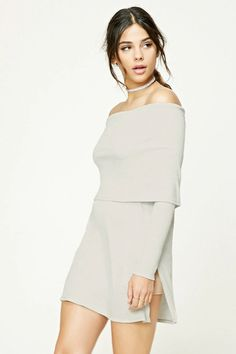 A heathered ribbed knit top featuring an off-the-shoulder neckline, long sleeves, side slits, and a longline silhouette.