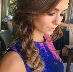 To copy Nina Dobrev's hairstyle, first divide your hair into three sections, and twist each clockwise. Then, braid the twists in the opposite direction.