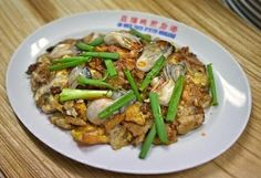 Fried oyster omelette from Ah Hock Fried Oyster Hougang. The stall won the Singapore Hawker Master title for the dish in 2013. More on Singapore hawker food at  http://www.straitstimes.com/singapore-hawker-food Photo: Alphonsus Chern/The Straits Times