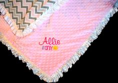Custom crib sized blanket with minkey and satin edging