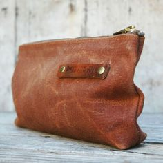Made from waxed canvas, keep your writing utensils together in this sleek and rustic Portable Office Carrier with Vintage Zipper or use it as a convenient way to carry around your important items.