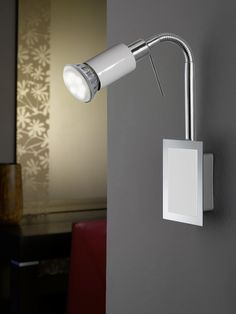The Eridan Flexible Single LED Spotlight has a 5 Watt LED in Warm White. The Eridan has a Gloss White finish with Chrome Detailing. The arm of this light is flexible so that Bedside Reading Light, Reading Lights, Kitchen Spotlights, Desk Lamp, Table Lamp, Modern Lighting, Flexibility, Sconces, Wall Lights
