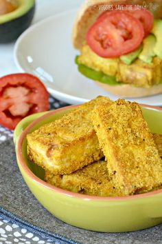 Breakfast Tofu strips marinated and baked with tamari, nutritional yeast, turmeric, and other spices.
