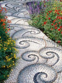 Garden path made of mosaic pebbles