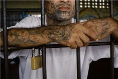 A member of the MS-13 gang does time inside the Ciudad Barrios prison in El Salvador. Newscom