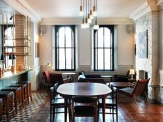 kitchen seating area with fireplace; British-style pub interior; High Road House London Redesign | Remodelista