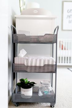 Nursery Organization Idea: Use a metal cart for diaper supplies next to the changing table!