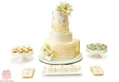 We worked with Paul Michael Events​ to create this special dessert for his client's birthday. His color palette was soft robin's egg blue pearly ivory, and gold. We created this three tier cake complete with hand-painted anemone flowers, soft ivory ruffles and quilting.  He wanted each guest to enjoy a dessert experience including a custom miniature cake, a gilded almond macaron and a tiny vanilla bean mousse caramelized white chocolate ganache tartlet.
