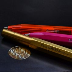 My attempt at Kaweco product photography 60mm Nikkor lens Nikon D7000. Brass Fountain pen and pink and orange sport pen