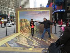 AERIAL AMERICA - A 3D art installation of the Grand Canyon by artist Kurt Wenner, was commissioned to promote Season 2 of Aerial America. The installation was placed in Times Square in NYC & at The Grove in LA for 2 days each. Consumers were encouraged to take their photo on the artwork, post to social media in order to receive a voucher for a complimentary, limited edition Smithsonian Channel cupcake. http://www.pinterest.com/vanwagnerexp/smithsonians-aerial-america-3d-art-installation/