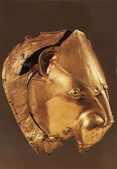 Solid gold lion beaker (wine cup) excavated from the royal graves at Mycenae, Greece -- National Archeological Museum, Athens