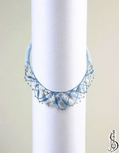 Necklace No.10973  		   Dark blue, light blue, white cotton and silver beads. Price: € 42 Other color variations are in the catalog.  ............................  Protected by copyright!