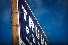 A barbed-wire wrapped Trump/Pence campaign sign in Erie, Pa., two days after the election, Nov. 10, 2016. (Photo: Hilary Swift / The New York Times)