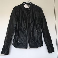 Leather jacket New. In Asian size it is XL but equivalent to L in US size.but it is like M size. So weird ...    Coating:100%polyurethane resin....... .......Fabric:100% viscose.....lining :100%polyester Jackets & Coats