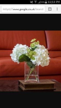 com agua falsa. White Hydrangea Arrangement Silk Flowers Greenery Spray Artificial Faux in Tall Square Vase Flores Allium, Allium Flowers, Fake Flowers, Silk Flowers, White Flowers, White Hydrangeas, Hortensien Arrangements, Artificial Flower Arrangements, Artificial Flowers