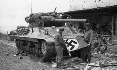 The crew of the American tank destroyer M36 GMC posing with a captured Nazi flag