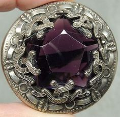 Brass button with large faceted amethyst jewel. Sold eBay 07/2017 by treasuresfoundhere!. $114.99