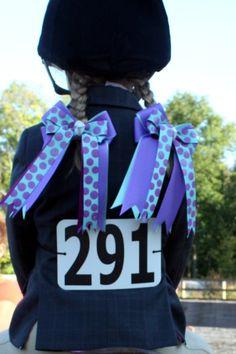 Purple and aqua horse show bows.