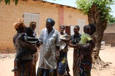 The midwife from a health centre talking to a group of mothers about malaria.
