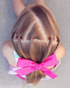 Ponytails are by far one of the easiest hairstyles to do and I love finding ways to spice them up a bit. I love doing elastic accents on the top or the side of my girls head before I put it in a p…