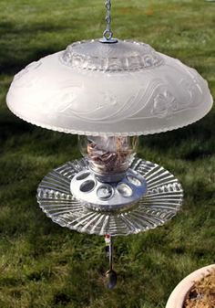 """Birdfeeder with old light cover for """"roof"""""""