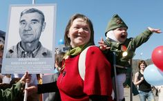 Image: Woman with child holds picture of World War Two soldier as she takes part in Immortal Regiment march during Victory Day celebrations in Divnogorsk 70th Anniversary, Mother And Child, World War Two, Troops, Victorious, Russia, March, Military, Woman