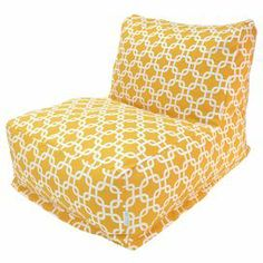 """Indoor/outdoor lounger in yellow with a links motif and eco-friendly fill. Made in the USA.   Product: LoungerConstruction Material: Polyester cover, recycled polystyrene fill and waterproof denier baseColor: Yellow and whiteFeatures:  Zippered slipcoverMade in the USA Suitable for indoor and outdoor useDimensions: 24"""" H x 27"""" W x 36"""" D Cleaning and Care: Slipcover is machine washable. Tumble dry low."""