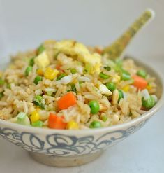 Fried Rice - minced ginger - red pepper flakes - carrots - fresh or frozen corn - fresh or frozen peas - scallion - grapeseed oil - rice - white pepper - low sodium soy sauce - large egg - toasted almonds or peanuts or cashew - cilantro - The Kitchn