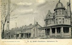 The architectually significant former W.H. Raab residence sits today, as in this postcard, across from Glatfelter's Furniture store on East Main street in Dallastown.