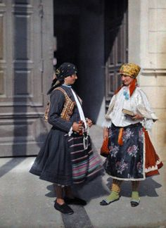 ca. June 1932, Mohacs, Hungary --- Two Serbian women stand in their brightly colored clothes --- Image by © Hans Hildenbrand/National Geographic Society/Corbis