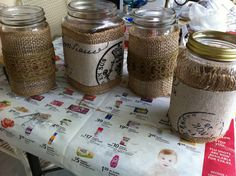 Mason jars decorated with burlap and fabric