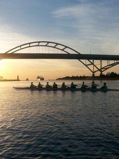Marquette Crew rows near Milwaukee's Hoan Bridge at sunrise. Photo credit: @MarquetteCrew: http://go.mu.edu/17TkiBM