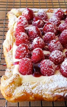 Rustic Raspberry Lemon Cheesecake Tart - a puff pastry crust, a lemon curd - cream cheese filling, topped with raspberries and raspberry jam.