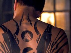 The movie's makeup artist, Brad Wilder, shares how Theo James and Shailene Woodley got their epic tattoos on set