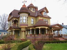 Victorian house. Love the porches and circular rooms and the vane.