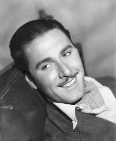 Errol Flynn smiling for the camera. #vintage #actors #leading_men
