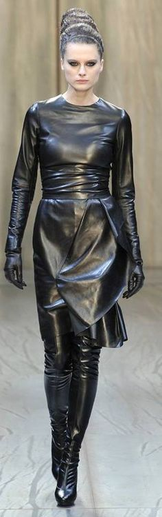 all in leather.... I think this would look considerably better if the model had a larger bust.