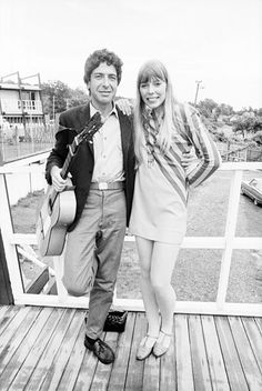 Leonard Cohen and Joni Mitchell arm in arm — somebody write a folk ballad immediately!    Newport Folk Festival, July 1967.