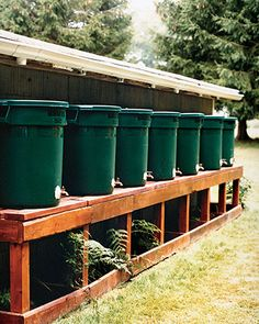 Reuse rainwater with these barrels made from trash cans. Placed underneath your home's downspout, a rain barrel can help conserve water (and money) by capturing rain runoff from the roof. You can then use that water for the garden Water From Air, Bokashi, Water Collection, Rainwater Harvesting, Water Storage, Organic Gardening Tips, Water Conservation, Water Garden, Money Saving Tips