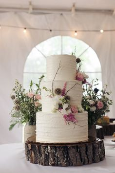 Simple three-tier wedding cake with textured frosting and fresh flowers {Daniele Carol Photography}